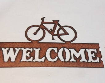 Bicycle Horizontal Welcome Sign made out of rusted metal