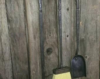 Wrought iron fireplace tool set.