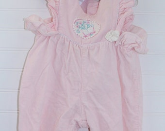 Vintage baby overalls. Pink overalls with satin detailing the chest. no name sz 3-6 mo