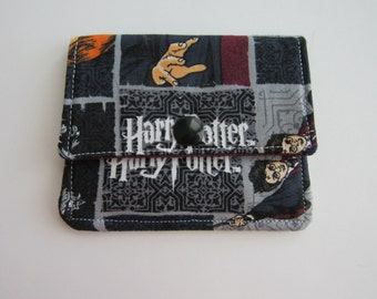 Compact Snap Wallet with card slots, and a pocket at the back for folded cash or receipts. Harry Potter