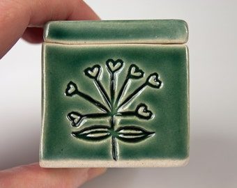 Handmade small green-blue ceramic box, heart-plant stamped, slab built, white stoneware