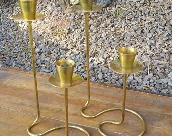 Brass candlesticks with swirled base.