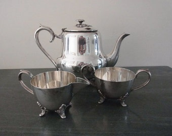 Antique Victorian style Silver plate teapot, sugar bowl and milk jug set circa 1930s made by Viners of Sheffield.  Made in England.