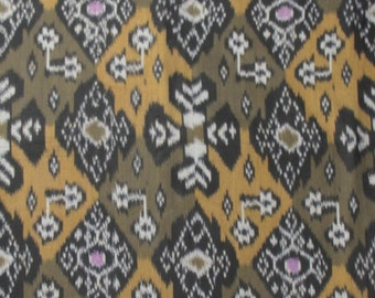Hand woven olive green, mustard yellow, black and cream patchwork cotton ikat fabric, textile by the yard