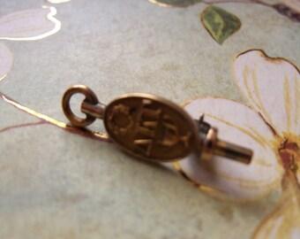 vintage gold 1929 faternity watch key