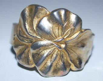 Metal floral cuff bracelet