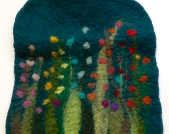 Hot water bottle with felted cover, grass and flowers, green
