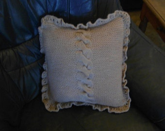 knitted cushion cover with cables