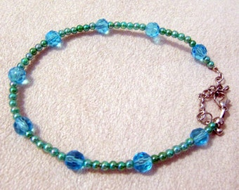 Teal beaded Bracelet with 9 crystal beads