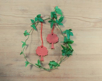 Set of two small sized red ceramic ornament leafy trees with lace pattern.