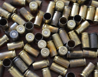 200 of 9mm caliber bullet shells/ casings/ cartridges