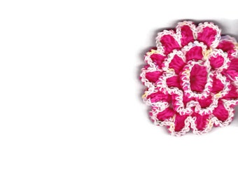 Pink, multicolored crocheted flower