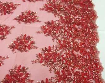 Red gleaming design emrboider and heavy beading on a mesh lace-yard