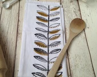 Hand printed tea towel - Mustard leaf design