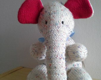 Multi colour fleck elephant with red ears.