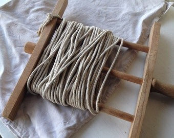 Vintage clothes line with linen bags for storing