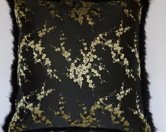 100% Pure chinese silk brocade cushion. Cherry blossom design in black and ivory. Trimmed in black marabou feather.