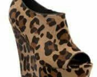 Cheetah print wedge shoes