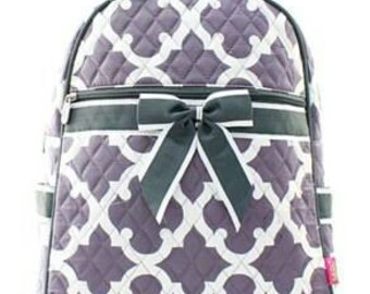 Quilted grey quatrefoil backpack