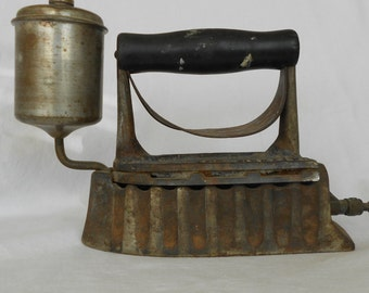 Antique clothes iron, 1903 Monitor gas sad iron