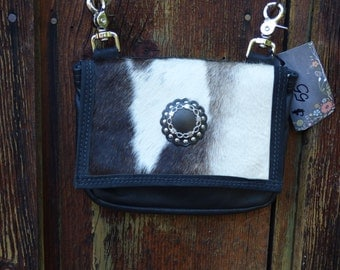Leather and Cowhide purse.