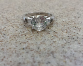 Sterling Silver Solitaire Ring wih Baggetts