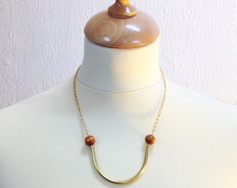 Curved pipe necklace