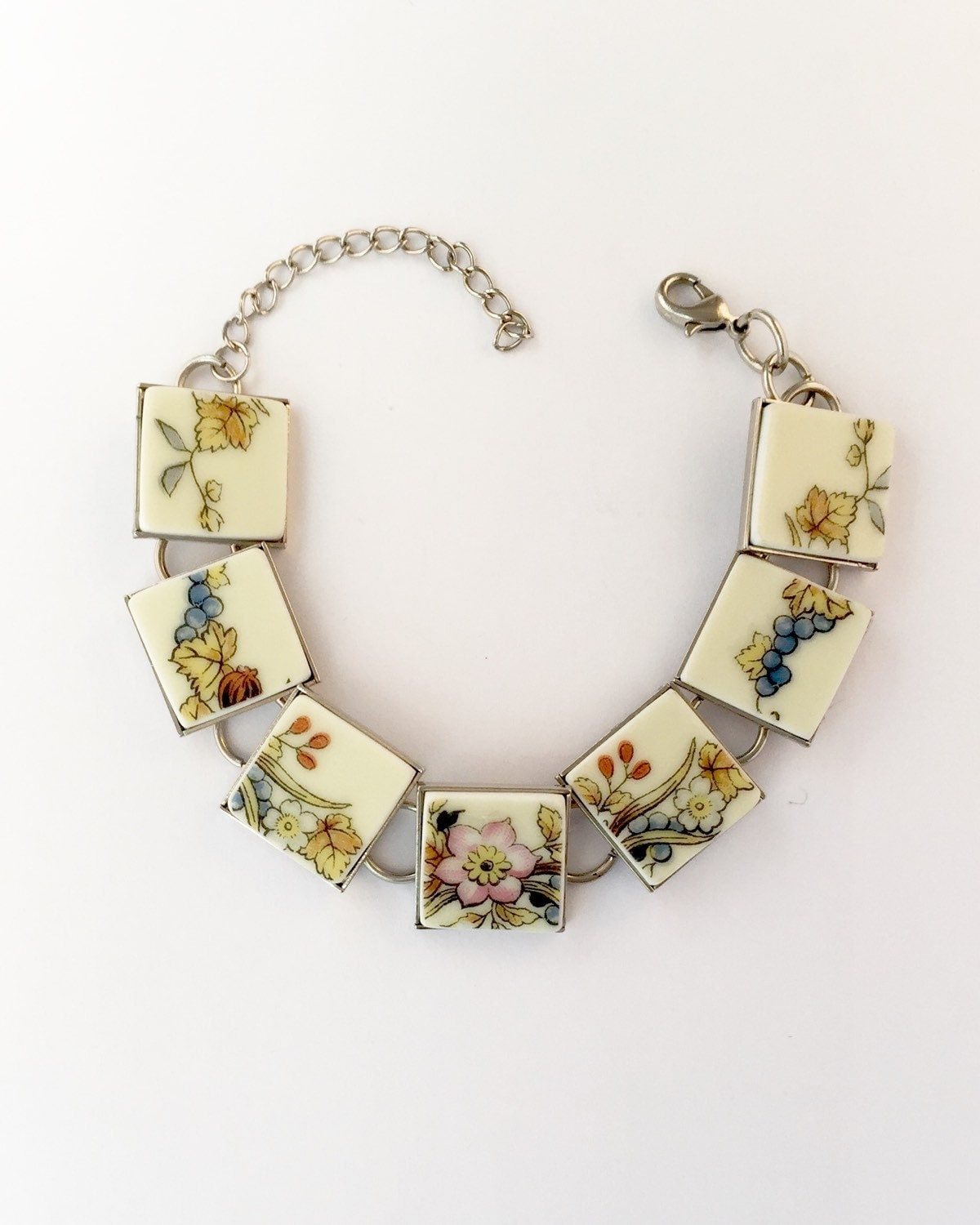 broken china jewelry cut from a vintage floral plate