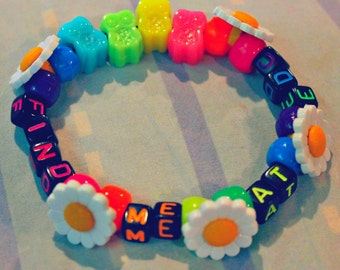 Find me at EDC Rainbow Neon Kandi with Daisies.