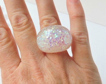 ICE QUEEN - hand cast resin ring in glossy clear resin with iridescent glitter highlights.  Size 7