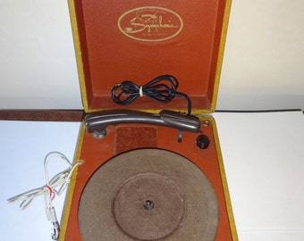 Vintage Symphonic Suitcase Record Player In Both Working and Non Working Condition.  Free Shipping