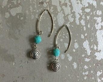 Aqua glass and silver metal drop earrings.