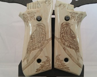 Stylized bird engraved TAURUS PT92/99FS grips