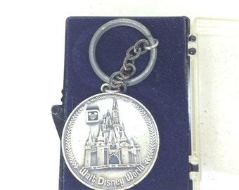 Walt Disney World Magic Kingdom Keychain - Featuring the 6 original lands including Fantasyland, Adventureland, Tomorrowland, Frontierland