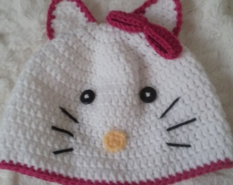 Cat-designed beanie hat for toddlers two to four years old in white with pink