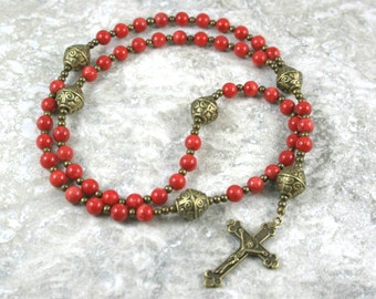 Bamboo coral and antiqued brass rosary in the Roman Catholic style