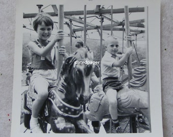 Vintage 1963 Photograph Boy and Girl on Merry Go Round Carnival Carousel Horse Black and White Snapshot Photo Picture from Vermont ~ 6758