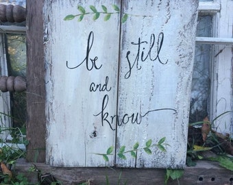Be still and know, rustic wood sign. Ivory paint with black writing