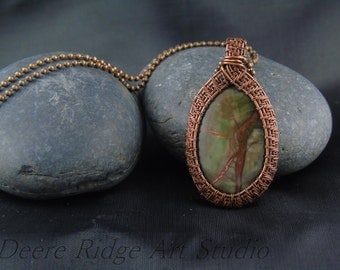 Wire woven copper and agate pendant with natural sierra agate stone.