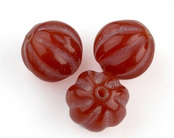 Carved carnelian melon beads 14mm sold individually. b4-car317(e)