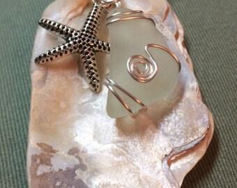 Aqua sea glass with sea shell
