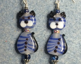 Blue and white lampwork cat bead earrings adorned with rhinestone collar and blue Czech glass beads.