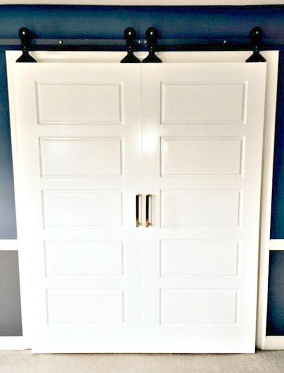 Double sliding barn door hardware top mount style by for Top mount barn door hardware