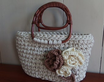 Handbag crochet from t shirt yarn with crochet flowers and rattan handles.