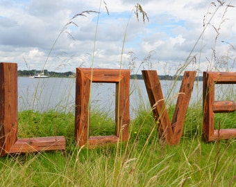 Large wooden letters as LOVE, Redign unique outdoor installation made from old roof beams