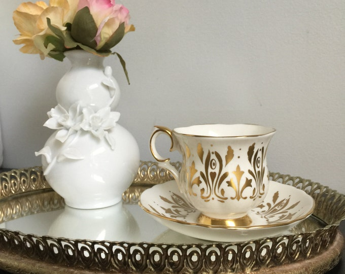 Crown Staffordshire Footed Teacup and Saucer in White and Gold