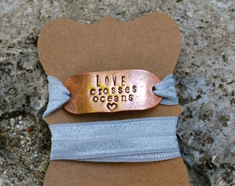 Hand-stamped {Love Crosses Oceans} Wrap Bracelet