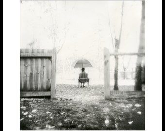 Under umbrella. Silver gelatin print from paper negative.