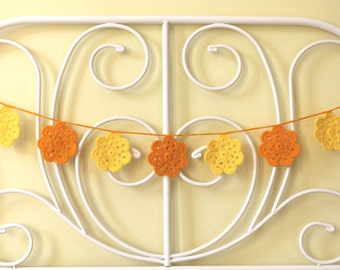 Crocheted orange and yellow flower bunting garland