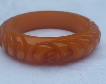 Vintage Bakelite carved bangle - orange